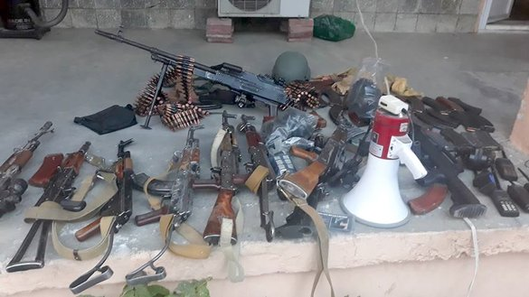 Kabul police said they seized various types of weapons and ammunition from Tamim Shansab's residence in Kabul on December 4. [Kabul Police/Facebook]