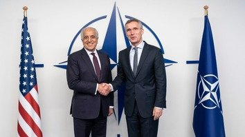 "US Special Representative for Afghanistan Reconciliation Zalmay Khalilzad (left) met with NATO Secretary General Jens Stoltenberg December 13 in Brussels as part of his meetings on peace in Afghanistan. ""We stand united in our desire for peace!"" Khalilzad's office tweeted December 14. [US Special Representative Zalmay Khalilzad/Twitter]"