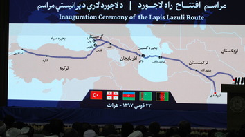 A map depicting the Lapis Lazuli Route is displayed on a screen during its inauguration ceremony in Herat Province December 13. [Omar]