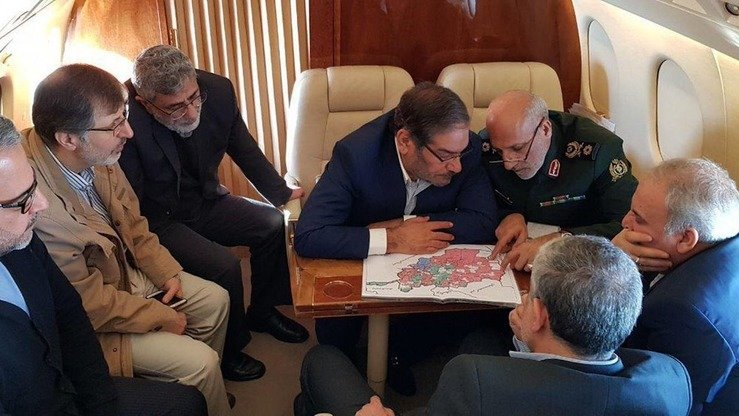 Ali Shamkhani, secretary of Iran's Supreme National Security Council (second right) along with other Iranian security officials, discusses Afghanistan's map on their way to Kabul December 26. [IRIB News Agency]