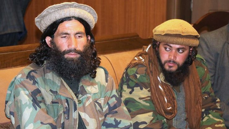 Former Taliban commander Mawlawi Abdul Haq (left), along with four of his followers, surrendered to Afghan authorities December 24 in Faizabad, capital of Badakhshan Province. [Badakhshan governor's press office]