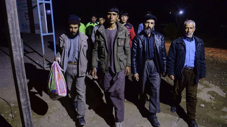 Afghan citizens arrive at an International Organisation for Migration (IOM) transit centre in Herat city after returning from Iran on January 2. The flow of Afghans forced to leave Iran turned into a flood in 2018, with a record number -- almost 800,000 -- coming back. [HOSHANG HASHIMI/AFP]