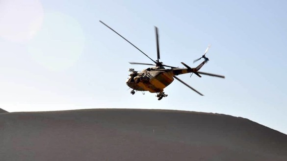 An Afghan National Army helicopter flies over Pusht Rod District, Farah Province, in an operation against Taliban militants December 6. [Afghan National Army 207th Zafar Corps press office]