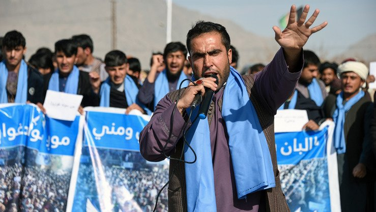 "Afghan protesters march for peace and ceasefire as they shout slogans and hold banners in the Kandahar province on January 17. Protesters marched holding placards saying: ""No War"", ""We want ceasefire"" and ""We want Peace"". [JAVED TANVEER / AFP]"