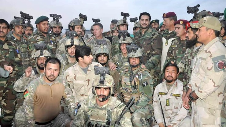 Acting Defence Minister Asadullah Khalid (top row, 5th right) and commander of NATO's Resolute Support Mission Gen. Austin Scott Miller (top row, centre) met with members of Afghan force and local officials in Faryab Province on January 7. [209th Shaheen Corps of the Afghan National Army/Facebook]