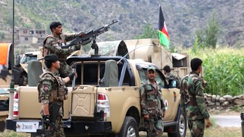 Afghan National Army commandos September 1 watch for militants during a clearance operation in the Dewagal Valley, Sawkai District, Kunar Province. [Khalid Zerai]