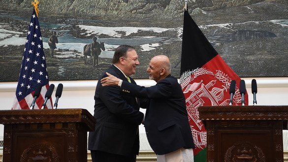 US Secretary of State Mike Pompeo shakes hands with Afghan President Ashraf Ghani after a press conference at the Presidential Palace in Kabul on July 9, 2018. [Wakil Kohsar/AFP]