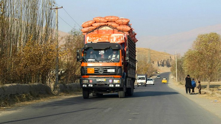 A truck transports goods along the Baghlan-Kunduz highway November 28. [Hedayatullah]