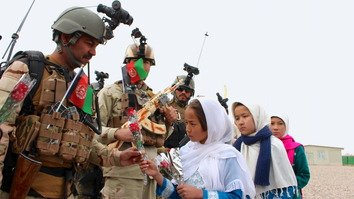 Afghans applaud soldiers' vows to defend country 'to our last drop of blood'