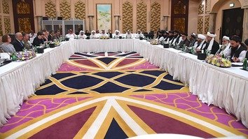 US Special Envoy Zalmay Khalilzad and Taliban representatives kick off the fifth round of Afghan peace talks February 25 in Doha, Qatar. [Qatari Foreign Ministry/Twitter]