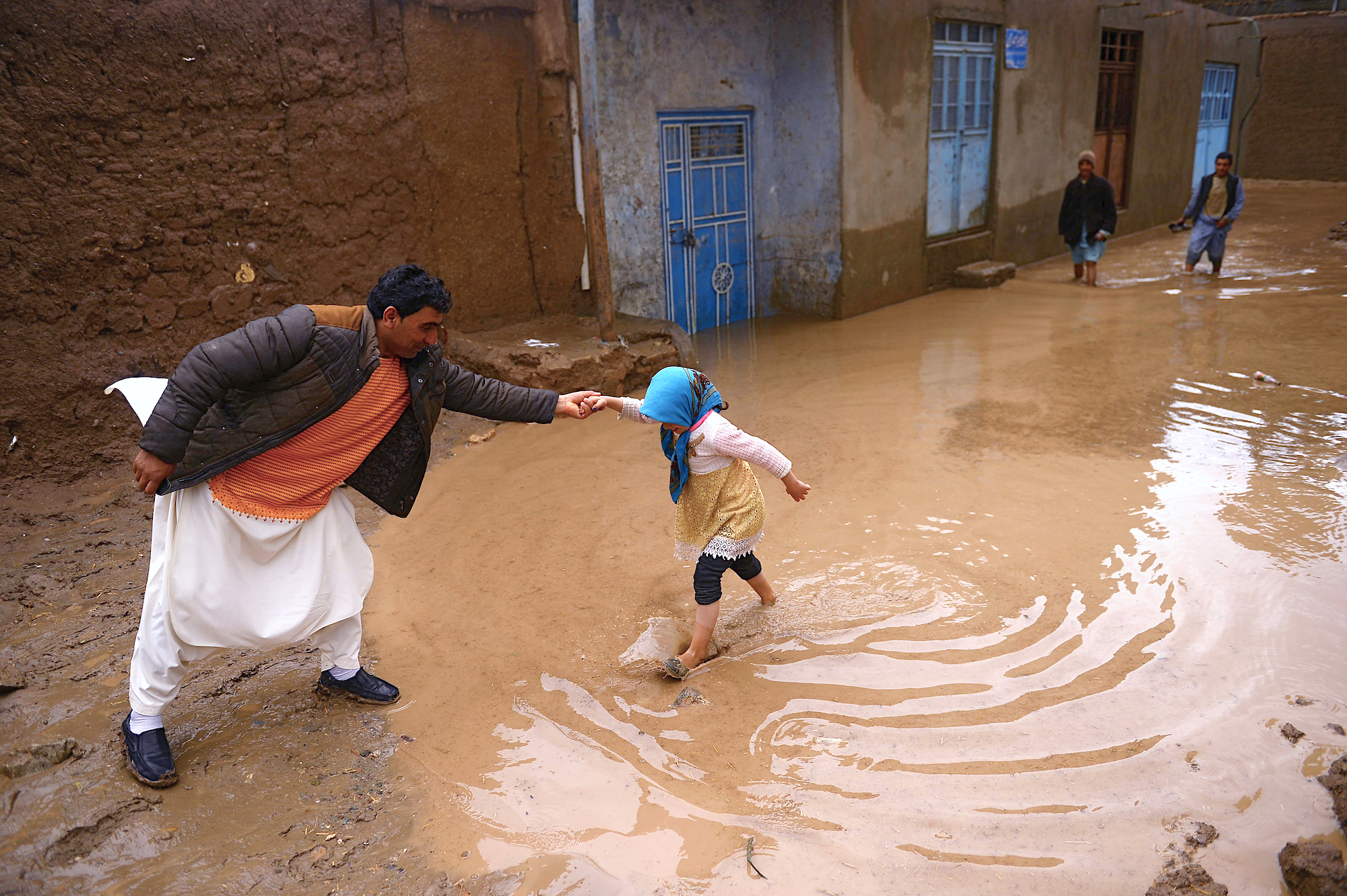 In photos: Afghans begin clean up after losing 'everything' in deadly floods
