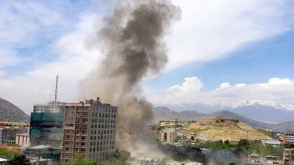 Smoke rises after an explosion rocked Kabul May 8. The Taliban claimed responsibility for the attack on an international NGO. [File]