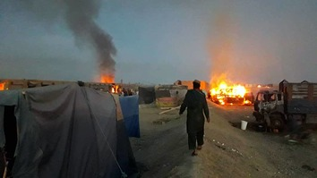 Taliban drug factories can be seen on fire following air strikes in Bakwa District, Farah Province. [Farah Provincial Police]
