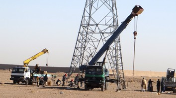 A Da Afghanistan Breshna Sherkat (DABS) technical team works to reconnect power lines on January 15 in Kusan District, Herat Province, after the Taliban blew them up. [Herat DABS]