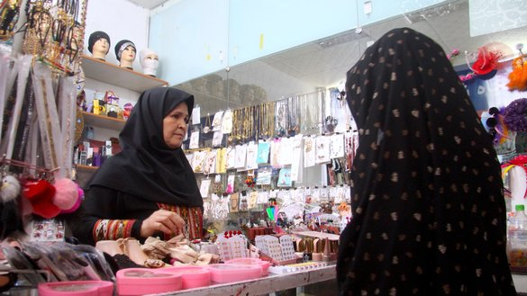 A female shopkeeper speaks to a customer at her store at the Khadījah al-Kubra Women's Business Centre May 7 in Herat city, Herat Province. [Omar]