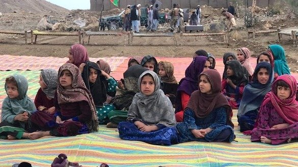 Schoolgirls attend a class in an open area in the Papin area of Haska Mina, Nangarhar Province, May 7. [Nangarhar governor's press office]