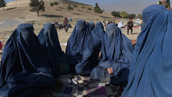 Afghan women who were displaced by Kunduz fighting between Afghan forces and Taliban insurgents gather at a makeshift camp on the outskirts of Kabul October 19, 2016. Aid organisations that have left since then have begun to return to the province. [Shah Marai/AFP]