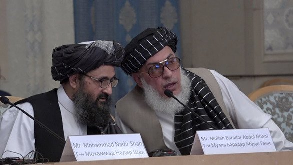 Afghan Taliban chief negotiators Mullah Abdul Ghani Baradar (left) and Sher Mohammad Abbas Stanekzai (right) appear May 28 in Moscow during a conference marking a century of diplomatic relations between Afghanistan and Russia, followed by discussions with Afghan opposition politicians about the future of the country. [Nikolay Korzhov/AFP]