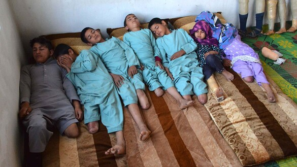 In this photo taken on May 3, Hamisha Gul's sons and grandchildren, who lost their legs following a rocket explosion, rest in their bedroom in Khogyani District, Nangarhar Province. [Noorullah Shirzada/AFP]