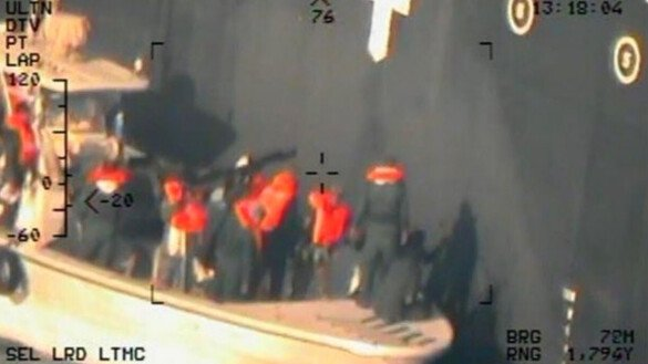 Imagery taken from a US Navy helicopter shows the Islamic Revolutionary Guard Corps removing an unexploded limpet mine from the M/T Kokuka Courageous June 13. [US Navy]