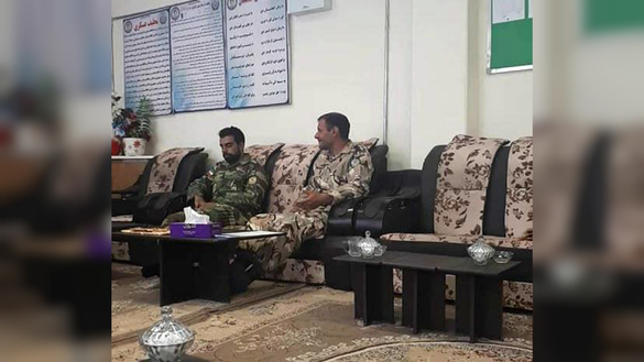 The two detained Iranian military personnel are seen here inside a Farah Province police station after they were taken into custody. [Farah Provincial Police]