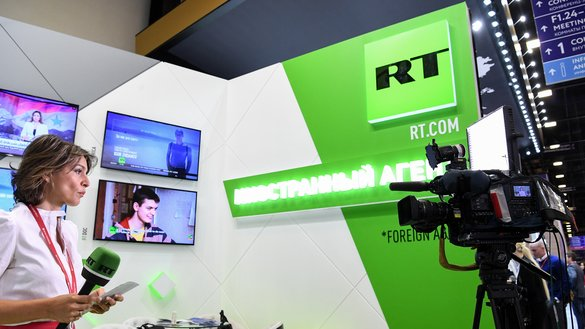 Shown is the stand of Russia's state-controlled RT broadcaster at the Saint Petersburg International Economic Forum on May 24, 2018. [Kirill Kudryavtsev/AFP]