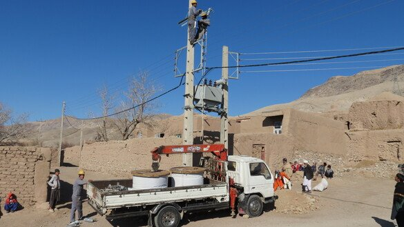 Workers connect power lines in Injil District, Herat Province, June 25 as part of the Citizens' Charter Afghanistan Project. [Herat Citizens' Charter Afghanistan Project]
