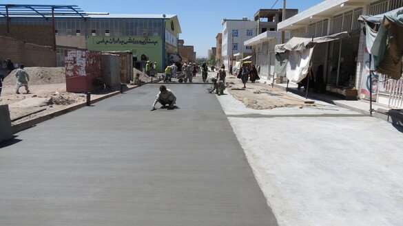 Workers from the Citizens' Charter Afghanistan Project cement an alley in 3rd District, Herat city, May 17. [Herat Citizens' Charter Afghanistan Project]