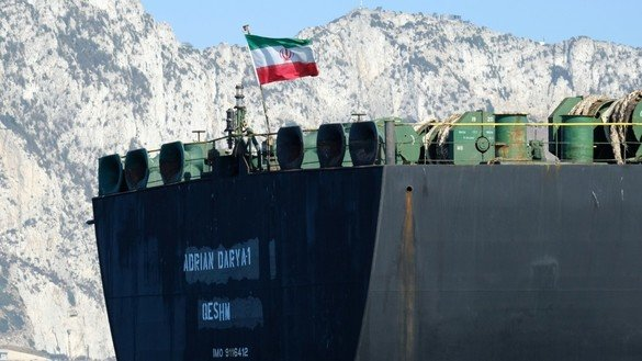 An Iranian flag flutters on board the Adrian Darya 1 oil tanker, formerly known as Grace 1, off the coast of Gibraltar on August 18. The tanker was seen off the coast of Syria on September 6 in an apparent violation of international sanctions. [Johnny Bugeja/AFP]