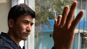 Afghan writer defiantly votes despite previous Taliban punishment
