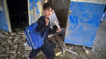 Students sift through remnants of their schools after deadly Taliban attack