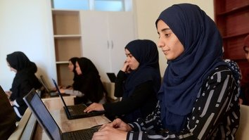 Bored by male heroes, Afghan girl coders build their own champions