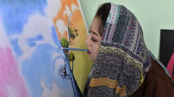 Afghan artist overcomes disability, discrimination to open art centre
