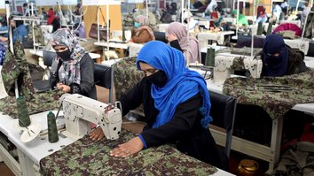 Afghan uniform factory offers lifeline to war widows