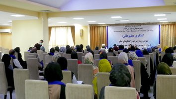 Afghan women stand together to warn of Taliban oppression